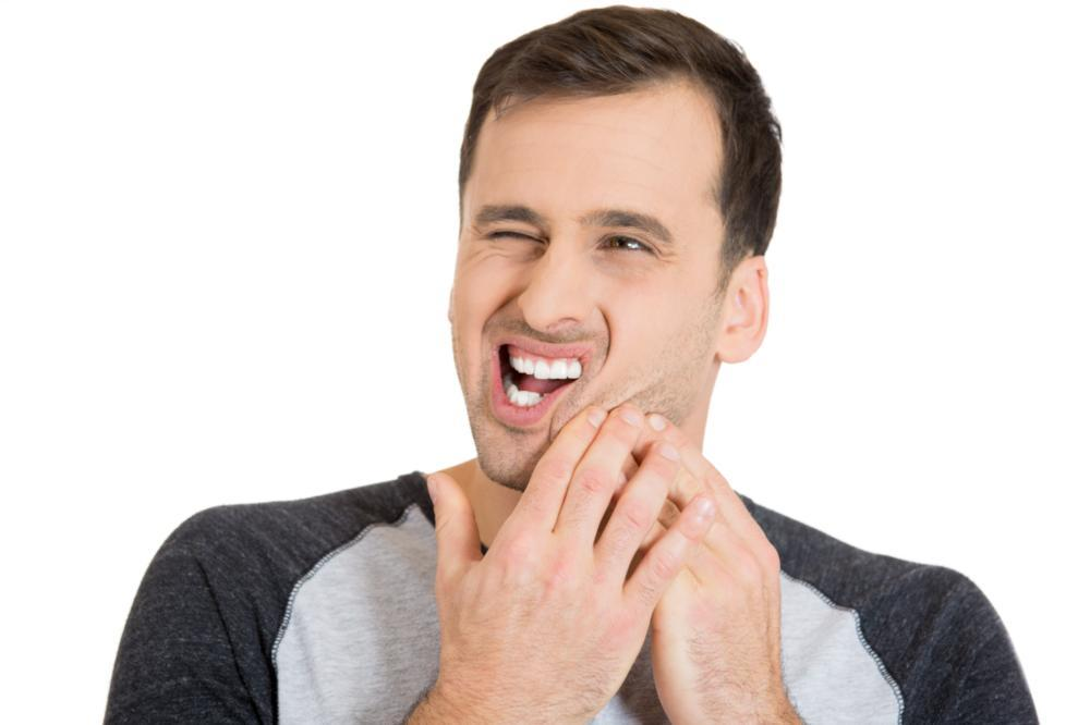 Man with TMJ Pain | TMJ Treatment in Fairfax