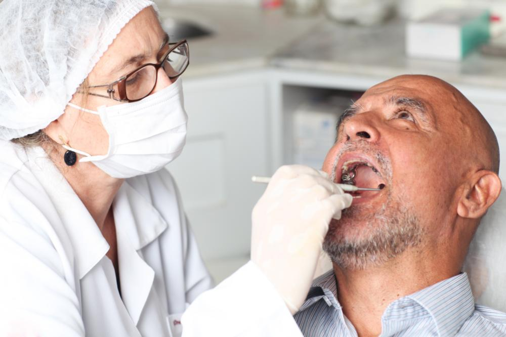Tooth Replacement in Fairfax VA | Man at Dentist